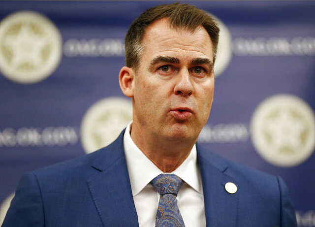 FILE - In this Feb. 13, 2020, file photo, Oklahoma Gov. Kevin Stitt speaks during a news conference in Oklahoma City, Okla. A state panel led by Gov. Stitt certified on Tuesday, Feb. 18, 2020, a relatively flat budget for the upcoming fiscal year, and the governor is urging the Legislature to use caution while drafting a state spending plan. (Nate Billings/The Oklahoman via AP File0