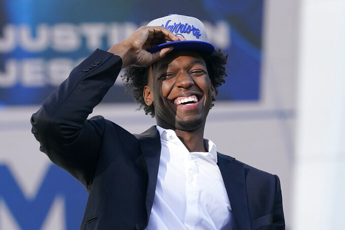 FILE - In this Nov. 19, 2020, file photo, Golden State Warriors draft pick James Wiseman laughs during a news conference in San Francisco. The 7-foot-1 Wiseman played only three college games as a freshman at Memphis. (AP Photo/Jeff Chiu, File)