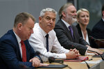 Britain's Brexit Secretary Stephen Barclay, second left, sits along with Britain's Brexit advisor David Frost, left, and British Ambassador to the EU Tim Barrow during a meeting with European Union chief Brexit negotiator Michel Barnier at the European Commission headquarters in Brussels, Friday, Sept. 20, 2019. (Kenzo Tribouillard/Pool via AP)