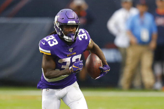 Minnesota Vikings running back Dalvin Cook runs with the ball during the second half of an NFL football game against the Chicago Bears Sunday, Sept. 29, 2019, in Chicago. (AP Photo/Charles Rex Arbogast)