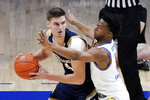 Notre Dame's Nate Laszewski, left, looks to pass as Pittsburgh's Femi Odukale, right, defends during the first half of an NCAA college basketball game, Saturday, Jan. 30, 2021, in Pittsburgh. (AP Photo/Keith Srakocic)