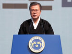 South Korean President Moon Jae-in speaks during a ceremony to mark the centennial of the March First Independence Movement Day against Japanese colonial rule (1910-45), in Seoul, South Korea, Friday, March 1, 2019. Moon says Seoul plans to discuss with Washington the possibility of restarting joint inter-Korean economic projects to induce nuclear disarmament from North Korea.(Hwang Kwang-mo/Yonhap via AP)