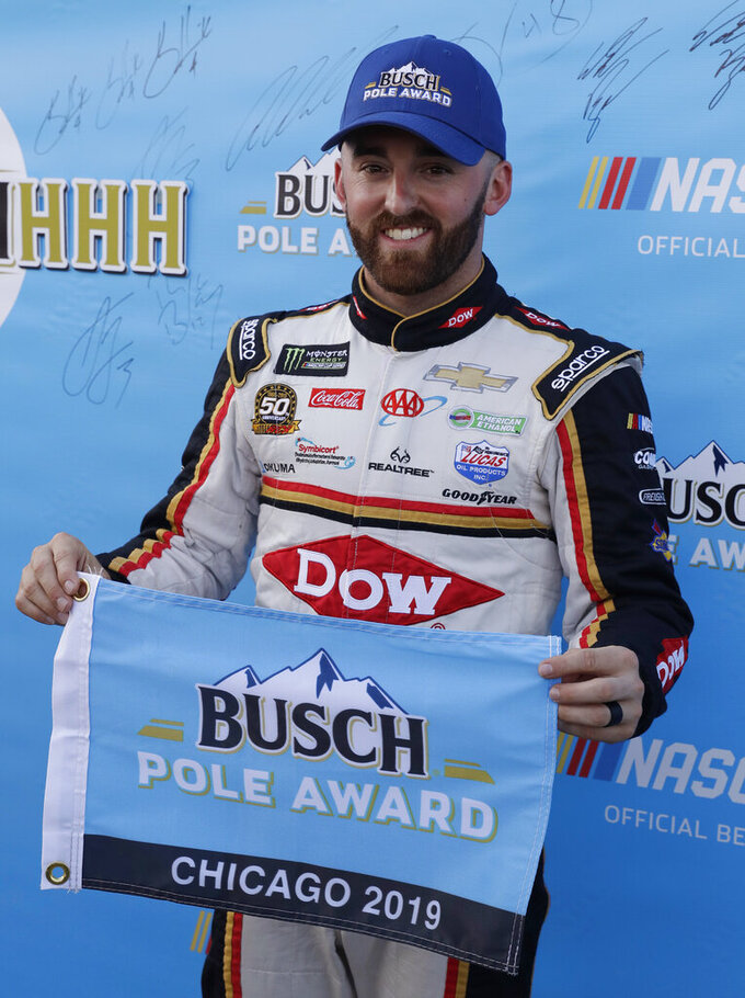 Austin Dillon holds the pole flag after winning the pole for the NASCAR Cup Series auto race at Chicagoland Speedway in Joliet, Ill., Saturday, June 29, 2018. (AP Photo/Nam Y. Huh)