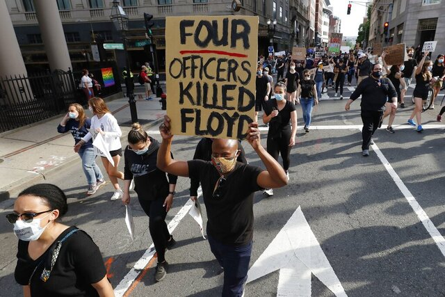 People march in protest against police brutality in Boston, Wednesday, June 3, 2020, following the death of George Floyd, who died after being restrained by Minneapolis police officers on Memorial Day. (AP Photo/Charles Krupa)