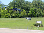A Tennessee Highway Patrol helicopter lands about 12:30 p.m. Monday at Covenant Ranch on Highway 79 northeast of Paris, Tenn. (Ken Walker/The Paris Post-Intelligencer via AP)