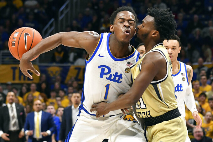 FILE  - Pittsburgh guard Xavier Johnson, left, collides with Georgia Tech guard Bubba Parham during the first half of an NCAA college basketball game in Pittsburgh, in this Saturday, Feb. 8, 2020, file photo. (Matt Freed/Pittsburgh Post-Gazette via AP, File)