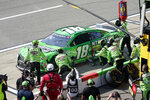 Kyle Busch makes a pitstop during the NASCAR Cup Series auto race at Michigan International Speedway, Sunday, Aug. 22, 2021, in Brooklyn, Mich. (AP Photo/Carlos Osorio)