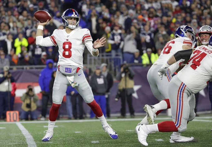 New York Giants quarterback Daniel Jones passes against the New England Patriots in the first half of an NFL football game, Thursday, Oct. 10, 2019, in Foxborough, Mass. (AP Photo/Elise Amendola)