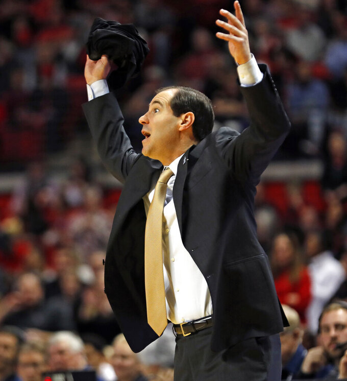 Baylor coach Scott Drew yells out after a foul call during the first half of an NCAA college basketball game against Texas Tech, Saturday, Feb. 16, 2019, in Lubbock, Texas. (AP Photo/Brad Tollefson)