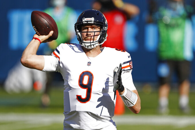 Chicago Bears quarterback Nick Foles (9) passes against the Tennessee Titans in the first half of an NFL football game Sunday, Nov. 8, 2020, in Nashville, Tenn. (AP Photo/Wade Payne)