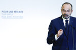 French Prime Minister Edouard Philippe delivers his speech Wednesday, Dec. 11, 2019 in Paris as he unveils proposals on pension reforms that might calm tensions on the seventh straight day of a crippling transport strike. (Thomas Samson/Pool via AP)