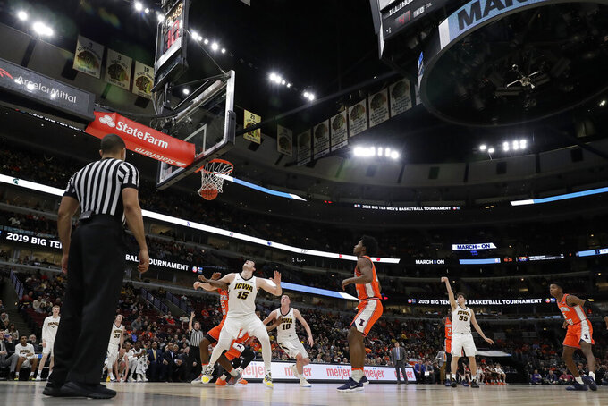 Iowa's Luka Garza (55) makes a 3-point shot during the second half of an NCAA college basketball game against the Illinois in the second round of the Big Ten Conference tournament, Thursday, March 14, 2019, in Chicago. (AP Photo/Nam Y. Huh)
