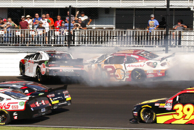 NASCAR Xfinity Series drivers Christopher Bell and Tyler Reddick crash during the NASCAR Xfinity auto race at the Indianapolis Motor Speedway, Saturday, Sept. 7, 2019 in Indianapolis. (AP Photo/Bud Cunningham)