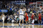 Dallas Mavericks forward Dirk Nowitzki (41) celebrates after sinking a basket in the first half of an NBA basketball game against the New Orleans Pelicans in Dallas, Monday, March 18, 2019. The basket placed Nowitzki as the sixth all-time league leading scorer surpassing Wilt Chamberlain. (AP Photo/Tony Gutierrez)