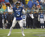 FILE - In this  Jan. 27, 2019, file photo, NFC quarterback Russell Wilson of the Seattle Seahawks throws a pass against the AFC during the first half of their NFL Pro Bowl football game in Orlando, Fla. Wilson posted a video to social media early Tuesday, April 16, 2019, saying,