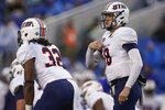 UT Martin quarterback John Bachus III (18) signals teammates during the first half of an NCAA college football game against Kentucky, Saturday, Nov. 23, 2019, in Lexington, Ky. (AP Photo/Bryan Woolston)