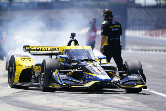 Colton Herta pulls out of the pits during practice for the IndyCar auto race at Indianapolis Motor Speedway, Friday, May 14, 2021, in Indianapolis. (AP Photo/Darron Cummings)