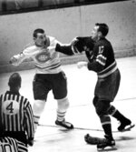 FILE - In this 1964 file photo, Montreal Canadiens' John Ferguson, top left, fights with New York Rangers' Bob Nevin, right, in New York. Nevin, a fan favorite who won two Stanley Cups with the Toronto Maple Leafs before a successful run as captain of the Rangers, has died. He was 82. The NHL said he died early Monday, Sept. 21, 2020, but did not give a cause. (The Canadian Press via AP, File)