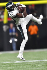 Philadelphia Eagles wide receiver Nelson Agholor (13) makes the catch against the Atlanta Falcons during the second half of an NFL football game, Sunday, Sept. 15, 2019, in Atlanta. (AP Photo/John Amis)