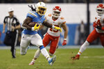 Los Angeles Chargers running back Melvin Gordon runs upfield during the first half of an NFL football game against the Kansas City Chiefs, Monday, Nov. 18, 2019, in Mexico City. (AP Photo/Marcio Jose Sanchez)
