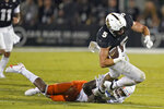 Central Florida running back Isaiah Bowser (5) is tripped by Boise State safety Tyreque Jones during the second half of an NCAA college football game, early Friday, Sept. 3, 2021, in Orlando, Fla. (AP Photo/John Raoux)