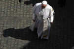 Pope Francis walks during his weekly general audience in the San Damaso courtyard, at the Vatican, Wednesday, June 9, 2021. (AP Photo/Alessandra Tarantino)