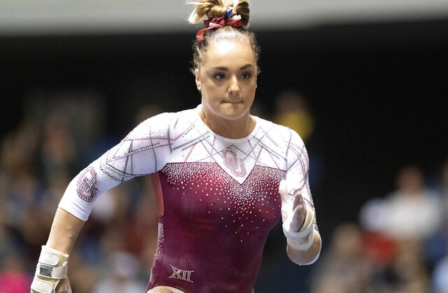 FILE - In this Jan. 4, 2020, file photo, Oklahoma's Maggie Nichols competes during an NCAA gymnastics meet in Anaheim, Calif. Two-time NCAA all-around champion gymnast Nichols and Heisman Trophy runner-up Jalen Hurts were honored Thursday, May 28, as the Big 12 Athletes of the Year, giving Oklahoma a sweep of the conference's top individual awards for the third time in five years. (AP Photo/Kyusung Gong, File)