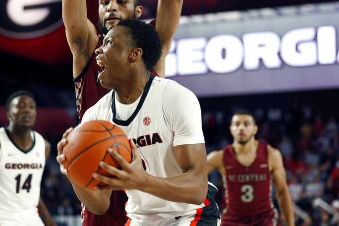 Georgia's Christian Brown (3) looks to shoot against North Carolina Central during an NCAA college basketball game Wednesday, Dec. 4, 2019, in Athens, Ga. (Joshua L. Jones/Athens Banner-Herald via AP)