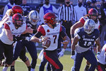San Diego State quarterback Kaegun Williams (7) looks to throw against Nevada during the first half of an NCAA college football game Saturday, Nov. 21, 2020, in Reno, Nev. (AP Photo/Lance Iversen)