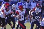 San Diego State quarterback Kaegun Williams (7) looks to throw against Nevada during the first half of an NCAA college football game Saturday, Nov. 21, 2020, in Reno, Nev. (AP Photo/Lance Iversen)