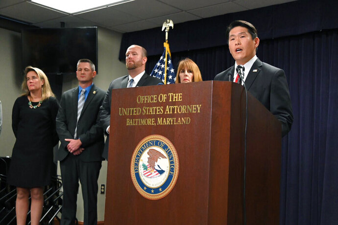 U.S. Attorney Robert K. Hur, right,  speaks at a press conference announcing the indictment of former Baltimore Mayor Catherine Pugh, Wednesday, Nov. 20, 2019, in Baltimore. Pugh was charged Wednesday with fraud and tax evasion involving sales of her self-published children's books. (Lloyd Fox/The Baltimore Sun via AP)