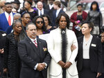 Maya Rockeymoore Cummings, second from right, watches pallbearers move the casket of her husband, Rep. Elijah Cummings, at the conclusion of his funeral service at New Psalmist Baptist Church, Friday, Oct. 25, 2019, in Baltimore. The Maryland congressman and civil rights champion died Thursday, Oct. 17, at age 68 of complications from long-standing health issues. (AP Photo/Steve Ruark)