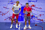 Dominic Thiem, of Austria, and Alexander Zverev, of Germany, pose for photos after the men's singles final of the US Open tennis championships, Sunday, Sept. 13, 2020, in New York. Thiem defeated Zverev in a tiebreaker. (AP Photo/Seth Wenig)