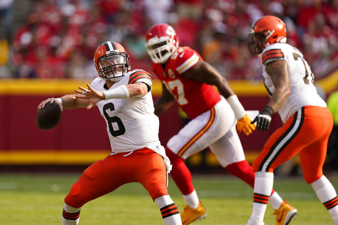 Cleveland Browns quarterback Baker Mayfield throws during the first half of an NFL football game against the Kansas City Chiefs Sunday, Sept. 12, 2021, in Kansas City, Mo. (AP Photo/Charlie Riedel)
