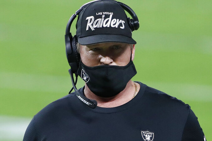 Las Vegas Raiders head coach Jon Gruden stands on the sidelines during the first half of an NFL football game against the Miami Dolphins, Saturday, Dec. 26, 2020, in Las Vegas. (AP Photo/Steve Marcus)