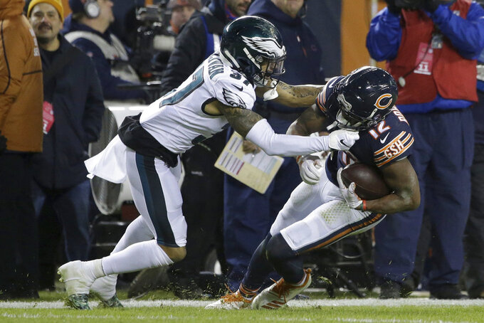 Philadelphia Eagles defensive back Tre Sullivan (37) tackles Chicago Bears wide receiver Allen Robinson (12) during the second half of an NFL wild-card playoff football game Sunday, Jan. 6, 2019, in Chicago. (AP Photo/David Banks)