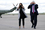 Vice President Mike Pence and his wife Karen remove their face coverings before speaking to members of the media at Andrews Air Force Base, Md., Monday, Oct. 5, 2020, as he leaves Washington for Utah ahead of the vice presidential debate. (AP Photo/Jacquelyn Martin)