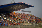 The so-called Orange Army, fans of Red Bull driver Max Verstappen of the Netherlands, fill the stands to watch the first free practice ahead of Sunday's Formula One Dutch Grand Prix at the Zandvoort racetrack, Netherlands, Friday, Sept. 3, 2021. (AP Photo/Francisco Seco)