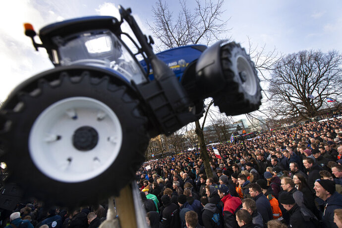 Some thousand of farmers converge on The Hague, Netherlands, Wednesday, Feb. 19, 2020, in the latest protest against the government's plans to rein in emissions of nitrogen oxide. (AP Photo/Peter Dejong)