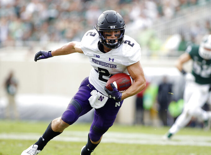 Northwestern's Flynn Nagel runs after a pass reception against Michigan State during the third quarter of an NCAA college football game, Saturday, Oct. 6, 2018, in East Lansing, Mich. Northwestern won 29-19. (AP Photo/Al Goldis)
