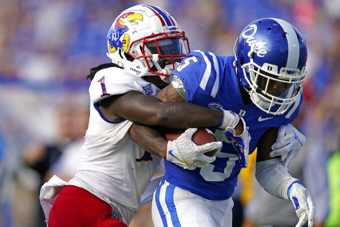 Duke wide receiver Jalon Calhoun (5) runs the ball while Kansas safety Kenny Logan Jr. (1) tackles during the first half of an NCAA college football game in Durham, N.C., Saturday, Sept. 25, 2021. (AP Photo/Gerry Broome)