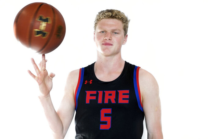 This Sept. 10, 2019, photo provided by Jessica Forbes shows Jake Murphy posed at PowerHouse Hoops basketball courts in Phoenix. The coronavirus pandemic put sports on hold and the AAU circuit with it, leaving non-elite basketball recruits with no opportunity to make an in-person impression on college coaches. Murphy opted to take the most sensible road rather than try sorting through the uncertainty, committing to play at the Air Force Academy, where his brother was already a cadet. (Jessica Forbes via AP)