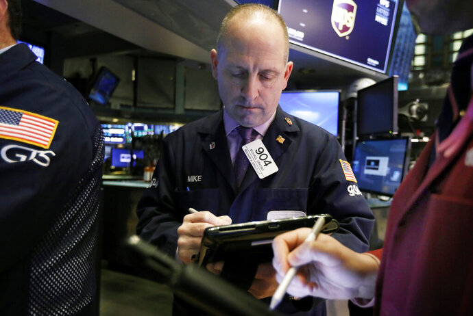 FILE- In this Feb. 5, 2019, file photo trader Michael Urkonis works on the floor of the New York Stock Exchange. The U.S. stock market opens at 9:30 a.m. EST on Thursday, Feb. 14. (AP Photo/Richard Drew, File)