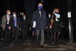 """EU Chief negotiator Michel Barnier, centre, wears a face mask as he leaves The Westminster Conference Centre in London, Thursday, Oct. 22, 2020. Barnier is in London to resume talks over post Brexit trade agreements. It's more than four years since Britain voted to leave the European Union, and almost a year since Prime Minister Boris Johnson won an election by vowing to """"get Brexit done."""" Spoiler alert: It is not done. As negotiators from the two sides hunker down for their final weeks of talks on an elusive trade agreement, Britain and the EU still don't know whether they will begin 2021 with an organized partnership or a messy rivalry. (AP Photo/Alberto Pezzali)"""