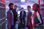 This image released by Netflix shows, from left, Marwan Kenzari, Matthias Schoenaerts, Charlize Theron, Luca Marinelli and Kiki Layne in a scene from