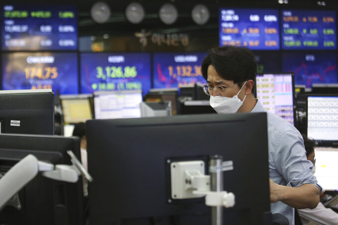 A currency trader watches monitors at the foreign exchange dealing room of the KEB Hana Bank headquarters in Seoul, South Korea, Thursday, May 13, 2021. Asian stock markets followed Wall Street lower for a second day Thursday after unexpectedly strong U.S. consumer price rises fueled worries inflation might drag on an economic recovery. (AP Photo/Ahn Young-joon)