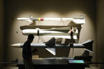 A visitor watches air-launched guided missiles used by the South Korean Air Force at Korea War Memorial Museum in Seoul, South Korea, Friday, July 23, 2021. Top U.S. and South Korean officials agreed Thursday to try to convince North Korea to return to talks on its nuclear program, which Pyongyang has insisted it won't do in protest of what it calls U.S. hostility. (AP Photo/Ahn Young-joon)