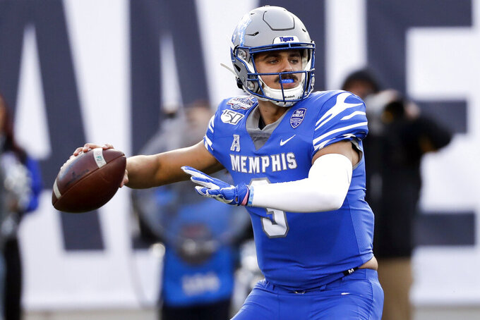 FILE - In this Dec. 7, 2019, file photo, Memphis quarterback Brady White passes against Cincinnati during an NCAA college football game for the American Athletic Conference championship in Memphis, Tenn. After winning their first American Athletic Conference last season, the Memphis Tigers want to make sure they do not skip a beat with head coach Ryan Silverfield now their third different coach in six seasons. (AP Photo/Mark Humphrey, File)