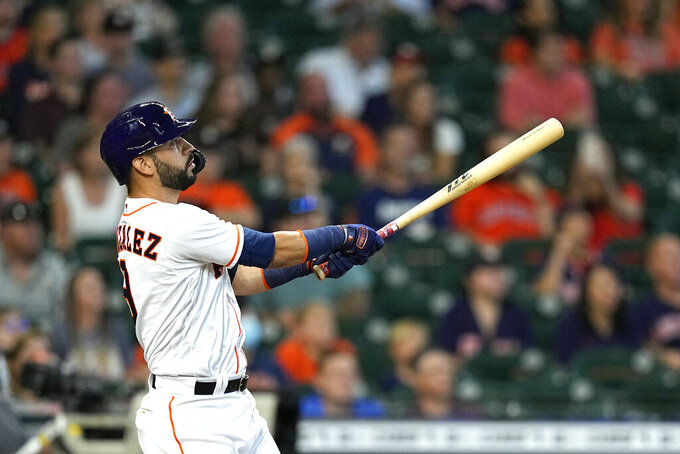 Houston Astros' Marwin Gonzalez hits a two-run home run against the Seattle Mariners during the second inning of a baseball game Wednesday, Sept. 8, 2021, in Houston. (AP Photo/David J. Phillip)