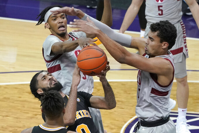 Washington guard Marcus Tsohonis, lower left, has his shot blocked by Stanford forward Oscar da Silva, right, and forward Ziaire Williams, upper left, during the first half of an NCAA college basketball game Thursday, Feb. 18, 2021, in Seattle. (AP Photo/Ted S. Warren)